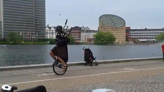 Darth vader playing scottish bagpipe on a unicycle view on ebaumsworld.com tube online.