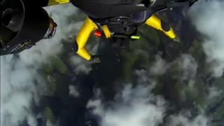 Jetman flies over Mount Fuji Yves Rossy soars over... view on ebaumsworld.com tube online.