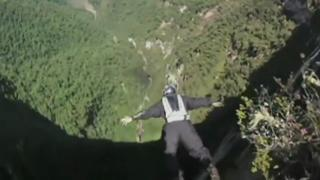 BASE jumper leaps from Gocta Waterfall in Amazon jungle. view on ebaumsworld.com tube online.