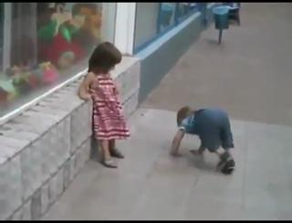 Little boy wants to steal a kiss from Little girl view on ebaumsworld.com tube online.