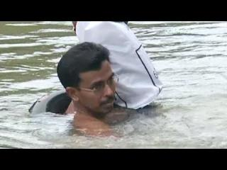 Teacher Swims Neck Deep in River To Get To Work in India view on ebaumsworld.com tube online.
