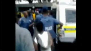 Police Brutality: Hand Cuffed to a police van and dragged away. view on ebaumsworld.com tube online.