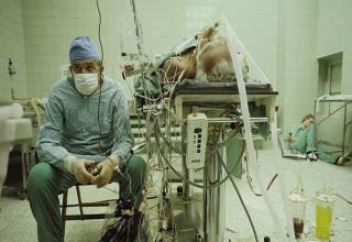 a doctor sits next to the operating table after a successful 36 hour operation