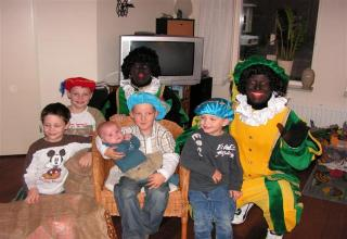 Black couple adopts white kids