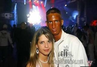 Guy with terrible spray tan poses with girl