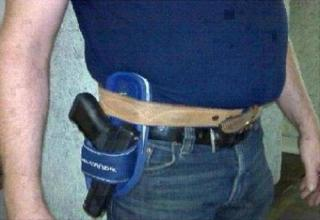 guy with a sandal for a gun holster