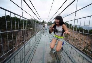 Terrified Tourists Struggle To Cross China's New Glass-Bottom Bridge