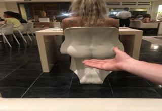 a woman sitting in a chair that looks like a butt