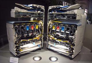 a copier machine cut in half showing its insides
