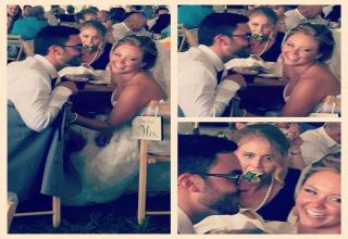 Girl stuffing her face as newly weds cozy up at their wedding table