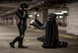 batman proposing to catwoman with a jug of milk