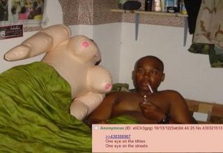 Cross-eyed guy in a bed next to a blow-up doll. Caption One eye on the titt