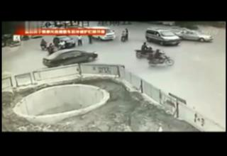 Drunk Scooter Guy Ends Up in Big Hole