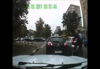Cyclist Breaks Car's Sideview Mirror view on ebaumsworld.com tube online.