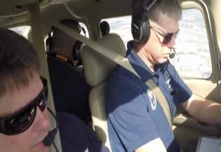 two pilots flying in a small cessna aircraft