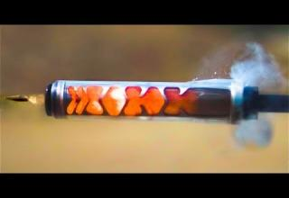 A See Through Silencer, Filmed at 110,000 Frames Per Second