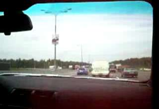 Two Cars Racing On A Russian Highway view on ebaumsworld.com tube online.