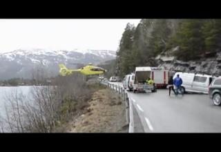 Helicopter Balances On Highway Guard Rail After Accident!!