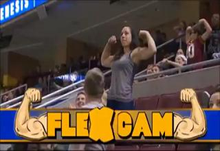 Girl flexes in front of guy. She has bigger muscles.