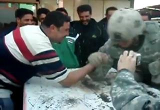Army Soldier Embarrasses Iraqi In Arm-Wrestling view on ebaumsworld.com tube online.