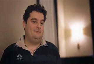 fat guy smiling in an apartment