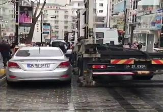 This tow truck can load a car in a minute.