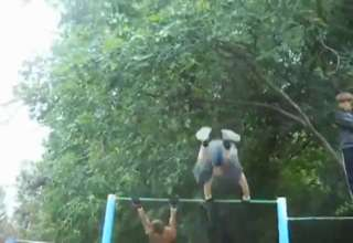 Guy goes flying off a horizontal bar view on ebaumsworld.com tube online.