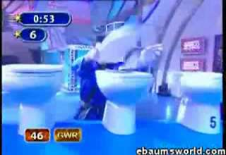Man Breaks Toilet Seats Over His Head