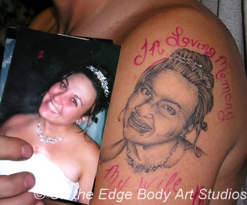 In loving memory of his dead wife... who now looks like a zombie.