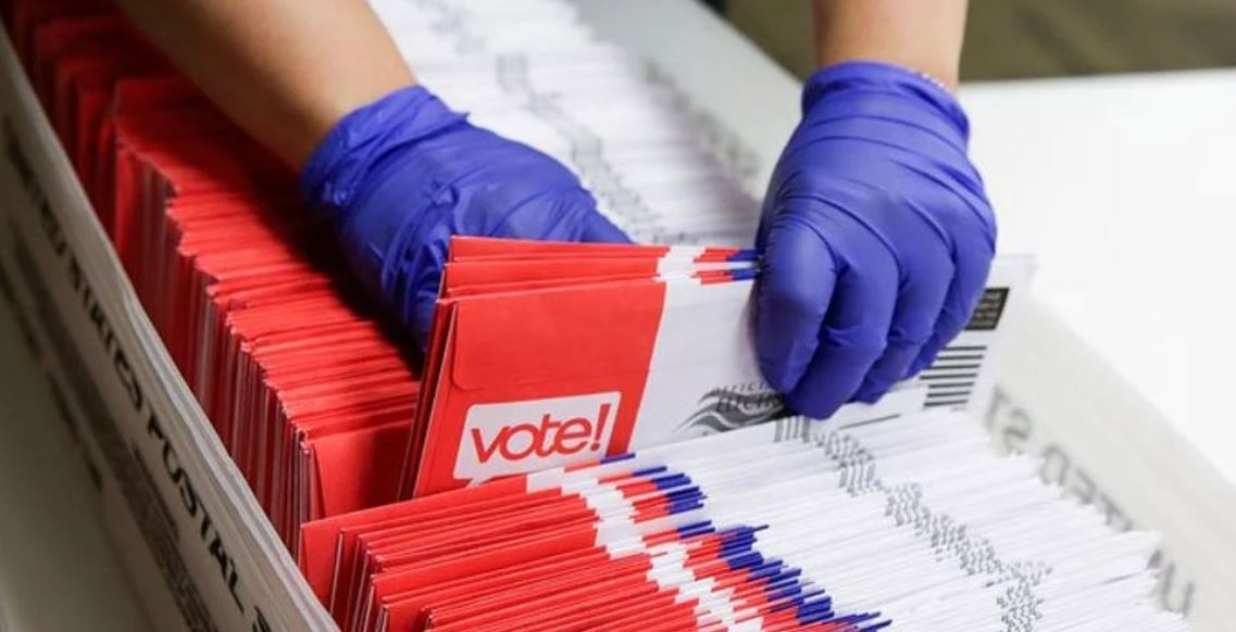 """Rhode Island election officials can now send out mail ballots without the witness and notary requirements GOP insisted upon. """"Your health should never be the price of admission to our democracy,"""" Rhode Island Secretary of State Nellie Gorbea."""