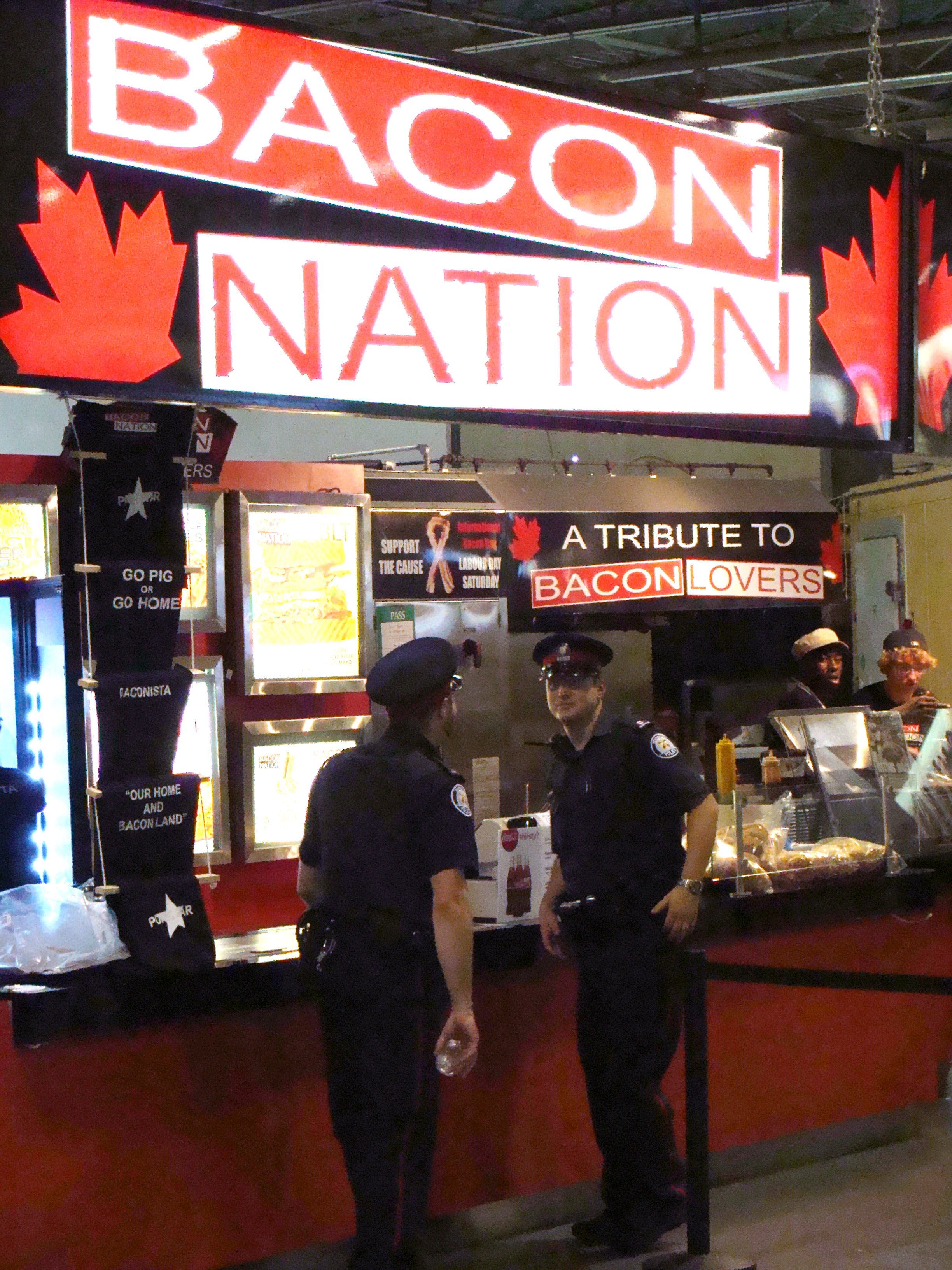 There are dozens of places to eat at in the Food Building at the Canadian National Exhibition, and look where these two end up. Oink! Oink!