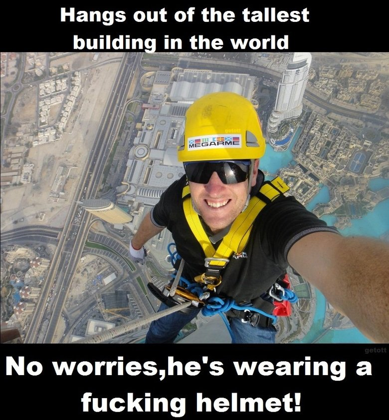 Guy takes the precaution of wearing a safety helmet.