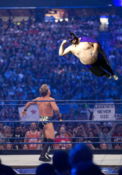 """Raven, off the ropes with his signature move,The Edgar Allan Elbow."""