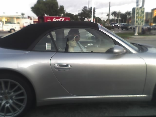 You would think that a man driving a Porsche Boxster could afford a little better girl friend