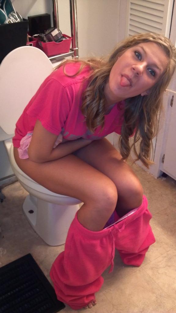 10 - Girls sitting on the toilet