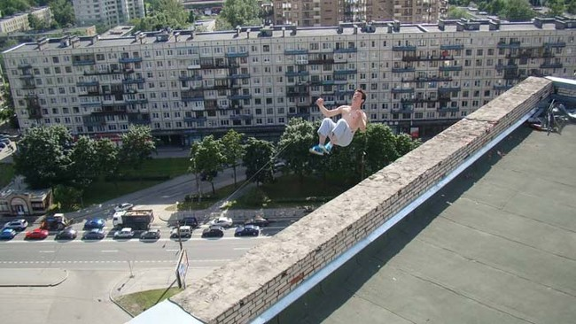 Russian freerunner Pavel Kashin attempting a backflip on top of a 16-story building. He landed successfully, but lost his balance and fell to his death.