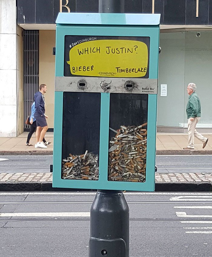 This cigarette bin lets you vote for things, promoting a clean environment at the same time.