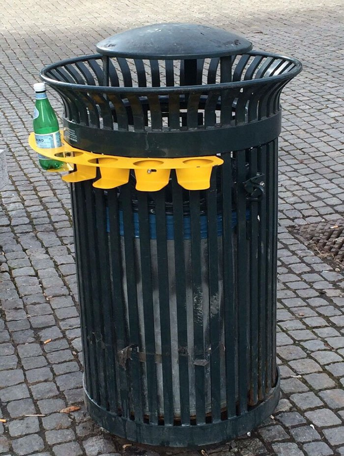 A trash can with a bottle rack so people don't have to dig through the garbage to find bottles and cans.