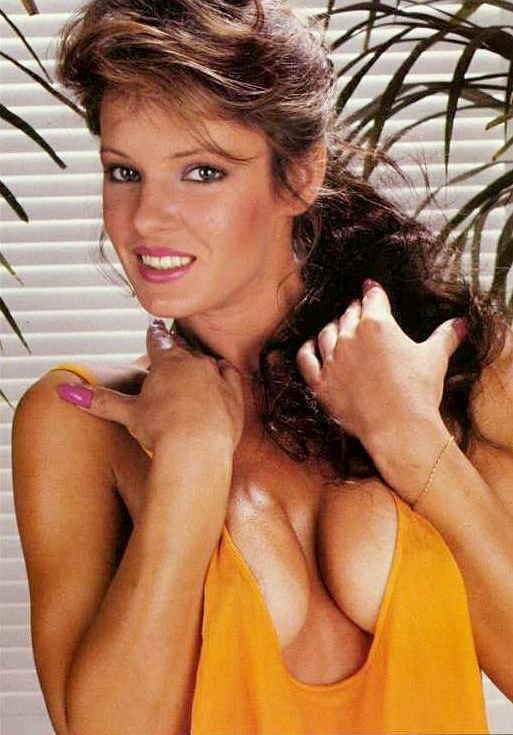 classic 80s porn - Beautiful 80s pornstar Aja in a very revealing orang tank top with cleavage