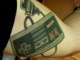 People with tattoos associated with video games.