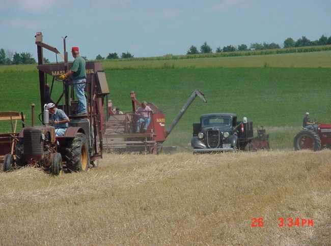 old massy combines and old truck at tractor show.