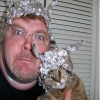 Pictures of real people who believe that tin foil hats protect them from government and alien mind control.