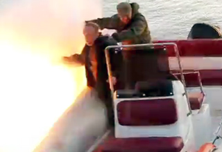 Russians drop a grenade into the water while on a boat...