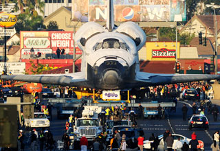 The Endeavour on its last mission, a 12-mile creep through Los Angeles.