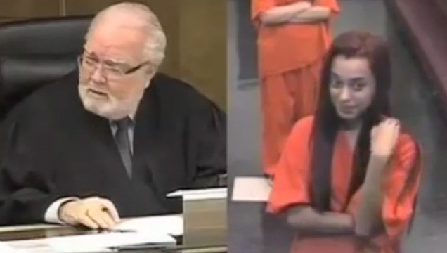 a judge and a young woman in an orange jumpsuit