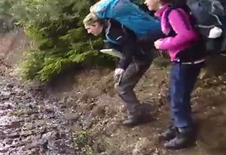 While trying to avoid the mud and jump on a rock, this lady does just the opposite and gives herself a faceplant in the process.