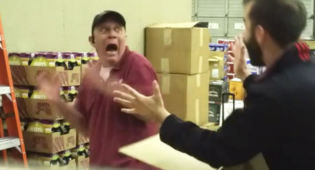 employee hides inside a box and scares his boss   video of an employee scaring his boss