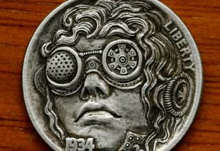 "A unique collection of awesome and artistically carved US coins, commonly referred to as ""Hobo Nickels""."