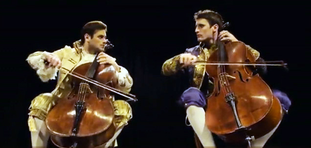 two guys playing the cellos