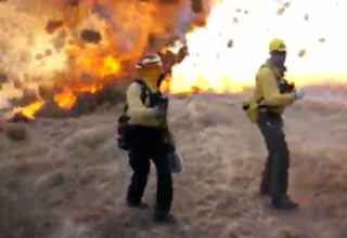 Here's something you don't see everyday, a tornado of tumbleweeds cause a blaze to intensify.